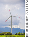 Wind power plant. green meadow with Wind turbines generating electricity 77568872