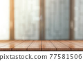 Empty wooden table top with lights bokeh on blur restaurant background. 77581506
