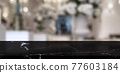 Empty black marble stone table top and blur restaurant background. 77603184