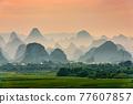 Guilin, China Karst Mountain landscape at Dusk 77607857