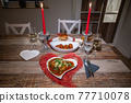 Valentines day dinner setting romantic love for two wooden table red heart shape candle light with Burger and Pasta 77710078