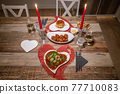 Valentines day dinner setting romantic love for two wooden table red heart shape candle light with Burger and Pasta 77710083