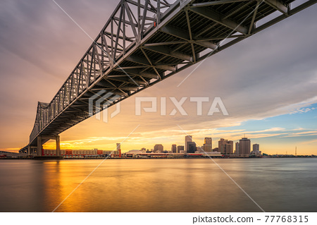 New Orleans, Louisiana, USA at Crescent City Connection Bridge over the Mississippi River 77768315