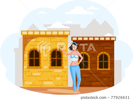 Female traveler standing making selfie, posting on instagram, social media next to old building 77926631