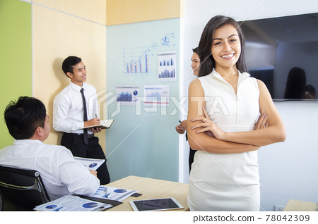 beautiful Asian business women standing in a modern collaborative office, smiling, looking at the screen of a tablet device, preparing a presentation about electronic devices. Cutting edge technology 78042309