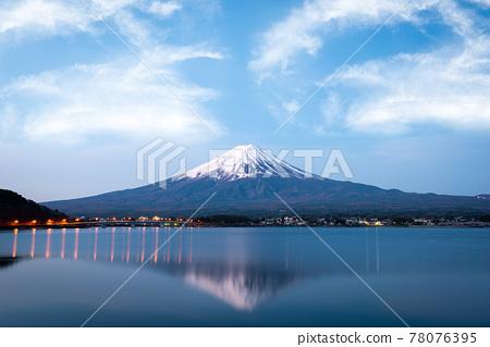 Mount Fuji at dusk near Lake Kawaguchi in Japan. 78076395
