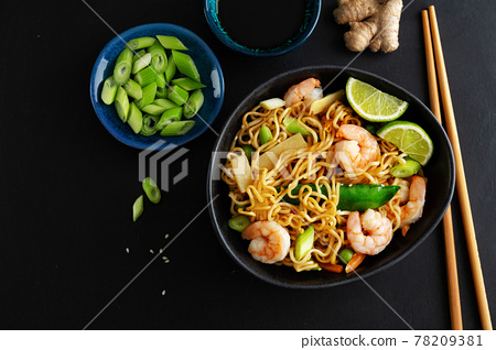 Asian noodles on plate on dark background 78209381