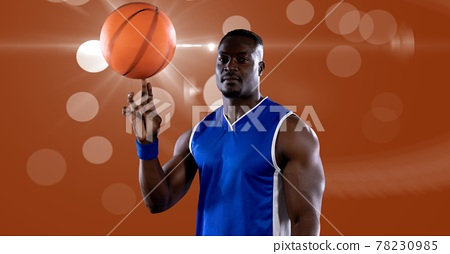 Composition of midsection of african american male basketball player turning ball with copy space 78230985