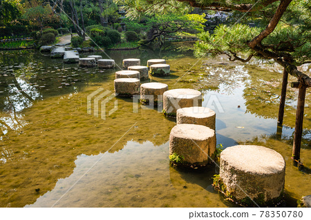 Stepping stones at Heian Shrine during spring season in Kyoto 78350780