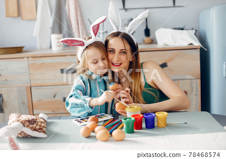Mother with little daughter in a kitchen 78468574