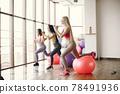Girls train in gym in sports uniform 78491936