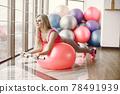 Girl train in gym in sports uniform 78491939