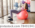 Girl train in gym in sports uniform 78491941