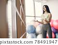 Girl train in gym in sports uniform 78491947