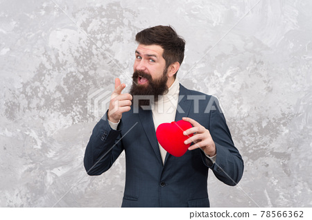 Id let my heart be yours. Bearded man with red heart  78566362