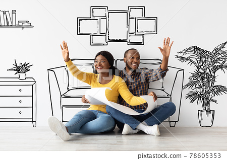 Young African American Spouses Holding House Plan And Dreaming About Interior Design 78605353