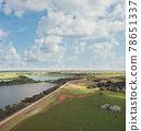 Countryside with a dirt road and lakes. Aerial view. 78651337