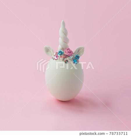 Single white egg, with unicorn decoration; Creative minimal Easter background 78733711