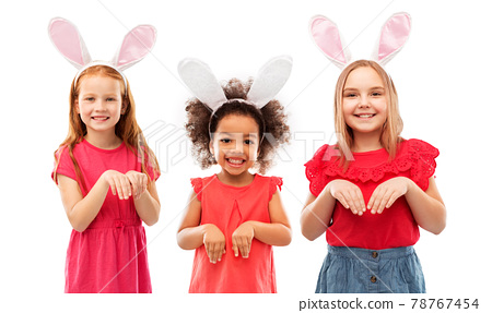 happy girls wearing easter bunny ears headbands 78767454