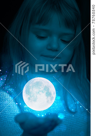 Little girl holding the moon and stars on the palm of her hand 78768840