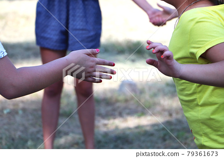 Children play the game and dance. The concept of friendship 79361673