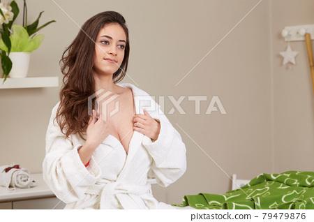 Female Enjoying Relaxing Massage In Cosmetology Spa Center 79479876