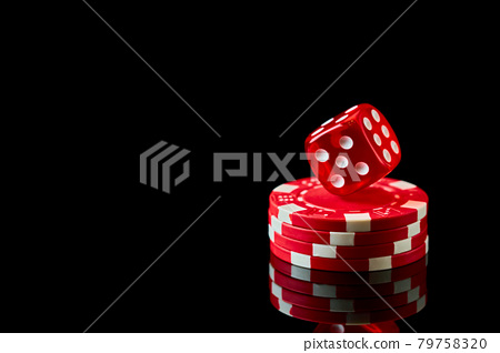 Red casino dice and chips isolated over black reflective background 79758320