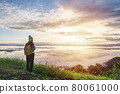 Young woman travelers looking at the sunrise and the sea of mist on the mountain in the morning, Travel lifestyle concept 80061000