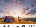 Young couple traveler looking landscape at sunset and camping on mountain, Adventure travel lifestyle concept 80061021