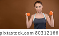 Portrait of a woman fitness athlete Caucasian. woman shows a gesture of strength. Studio photo 80312166