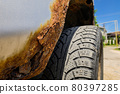 Rusty wheel arches on the car. car corrosion. Background for welding work on the restoration of the car body 80397285