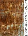 Rust on the surface of the iron with paint. Grunge texture background 80397289