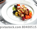Grilled quail with vegetable stew, light plate table with white tablecloth and cutlery 80400515