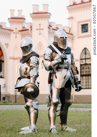 Two knights in armor on the background of the medieval Kossovsky castle.A medieval concept.Metallic texture 80507867