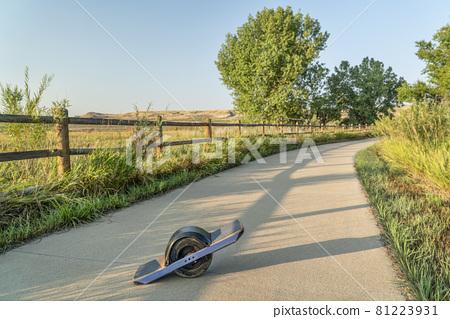 one-wheeled electric skateboard on a bike trail 81223931