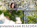 Portrait of happy pretty young woman outdoors on spring sunny day. 81321454