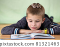 Close up portrait of smiling little boy reading book with small pet hamsters. Concept of studying with good mood. 81321463