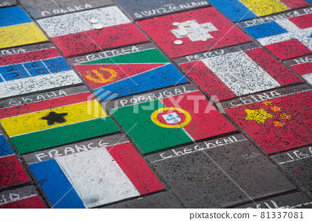 Closeup of world flags drawing in the street 81337081