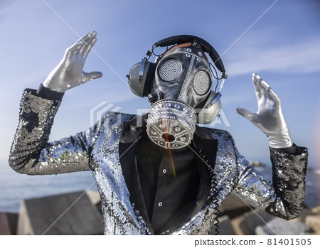 man with sparkling gas mask dancing by the sea 81401505