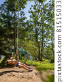 Male kid relaxing playing on rope swing bungee at forest nature camp enjoying summer travel vacation 81515033