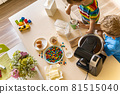Two cheerful male children cooking homemade baking dessert together mixing ingredients for dough 81515040