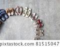 Top view many colored female shoes on gray floor footwear wheel fashion stylish footgear choosing 81515047