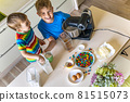 Top view baby brothers kids cooking dessert together use fresh healthy ingredients at kitchen 81515073