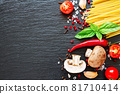 Tomatoes, spaghetti, spices, garlic and basil leaves on black background. 81710414