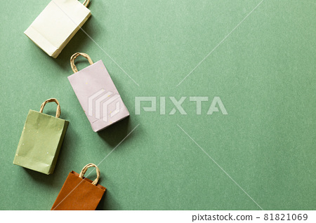 Paper shopping bags on green background. top view, copy space 81821069