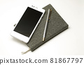Notebook with pen and smartphone 81867797