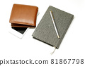 Notebook with pen smartphone and brown leather wallet 81867798