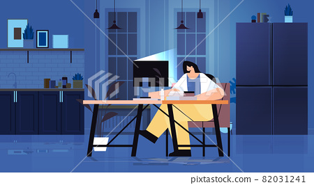 overworked businesswoman sitting at workplace business woman freelancer looking at computer screen 82031241