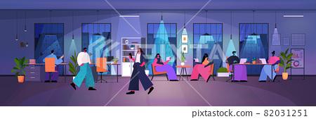 businesspeople using digital gadgets business people working in modern dark night office horizontal 82031251
