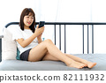 Young woman having an online meeting at home 82111932